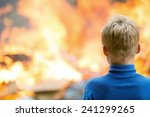 human child boy at burning... | Shutterstock . vector #241299265