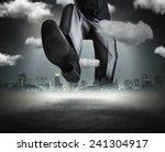 huge businessman goes across... | Shutterstock . vector #241304917