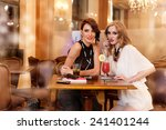 two young women in a bar... | Shutterstock . vector #241401244