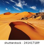 Small photo of Sand dunes and rocks, Sahara Desert, Algeria