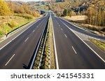 empty highway between deciduous ... | Shutterstock . vector #241545331