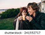 mother and daughter drinking... | Shutterstock . vector #241552717