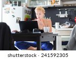 female freelancer in her casual ... | Shutterstock . vector #241592305