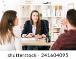 young woman working at her desk ... | Shutterstock . vector #241604095