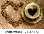 Hot coffee in a cup and grains on a copper Asian - stock photo