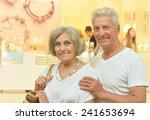 senior couple at shopping mall | Shutterstock . vector #241653694