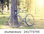 old bicycle leaning against a... | Shutterstock . vector #241773745