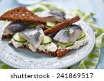 Stock photo sandwich with herring cucumber and soft cheese 241869517