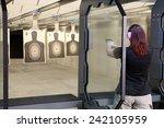 Small photo of Idaho Falls, Idaho, USA Nov. 18, 2014, Shooters practicing tactical shooting in a modern indoor gun range.