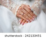 hands of a bride with a ring... | Shutterstock . vector #242133451