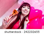 woman partying in night club | Shutterstock . vector #242232655