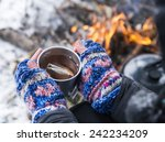 hands holding hot tea cup... | Shutterstock . vector #242234209