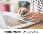 girl using her laptop in her... | Shutterstock . vector #242277511