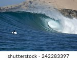 A Surfer Watches A Tube Break...