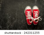 Red Sneakers On Black...