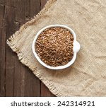 Flax Seeds In A Bowl On A...