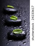 black stones whit leaf of mint and drops - stock photo