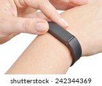 activity tracker on a woman's... | Shutterstock . vector #242344369