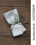 wedding favor on old wooden... | Shutterstock . vector #242350849