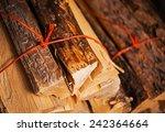 bundles of pine firewood... | Shutterstock . vector #242364664