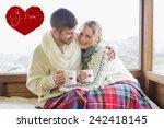 loving couple in winter wear... | Shutterstock . vector #242418145