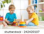 children brothers playing... | Shutterstock . vector #242420107