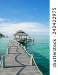 tropical hut and wood bridge at ... | Shutterstock . vector #242422975