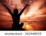young girl rising her hands to...   Shutterstock . vector #242448925