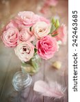 Bright romantic vertical background with roses feathers and bokeh - stock photo
