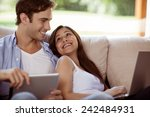 young couple relaxing with a... | Shutterstock . vector #242484931