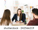 young woman working at her desk ... | Shutterstock . vector #242566219