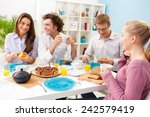 four friends having breakfast... | Shutterstock . vector #242579419