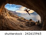 female rock climber posing... | Shutterstock . vector #242615965