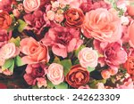 Stock photo wedding bouquet with rose bush ranunculus asiaticus as a background 242623309