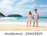 lovely couple on tropical beach ... | Shutterstock . vector #242625829