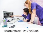 two female dentist looking at x ... | Shutterstock . vector #242723005
