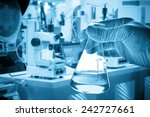 flask in scientist hand with... | Shutterstock . vector #242727661