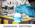 flask in scientist hand with... | Shutterstock . vector #242727664
