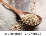 green buckwheat spilling in a... | Shutterstock . vector #242748829