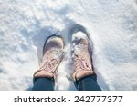 boots in the snow | Shutterstock . vector #242777377