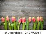 Fresh Tulips Arranged On Old...