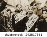 Small photo of New York City May Day celebration of the international labor day. Two girls in the parade combined carrying an American flag, the slogan ABOLISH CHILD SLAVERY!! In English and Yiddish. 1909.