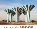 Blue And White Water Towers In...