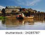 Cambodian Women Sail On A Boat...