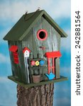 a colorful birdhouse on a trunk | Shutterstock . vector #242881564