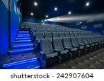 empty cinema seat with blue... | Shutterstock . vector #242907604