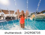 cute girl in a pool at summer | Shutterstock . vector #242908735