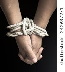 Small photo of Victim boy with hands tied up with rope in emotional stress and pain, afraid, restricted, trapped, call for help, struggle, terrified, International Day for the Abolition of Slavery, Stop concept.