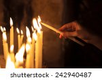 Woman Lighting Candles  In A...