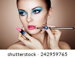 makeup artist applies lipstick. ... | Shutterstock . vector #242959765